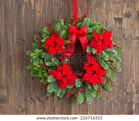 Advent wreath with winter rose as decoration - stock photo