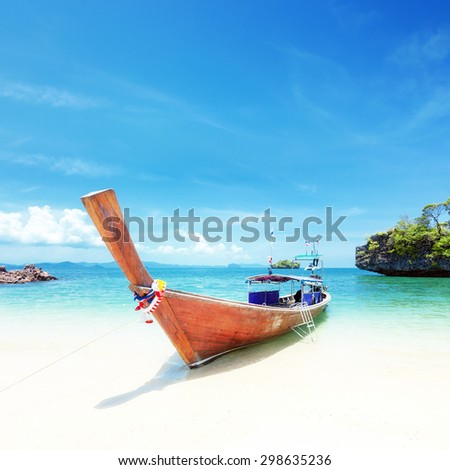Adventure background. Wooden tourist boat on shore of Asian tropical resort. Traveling to Thailand  - stock photo