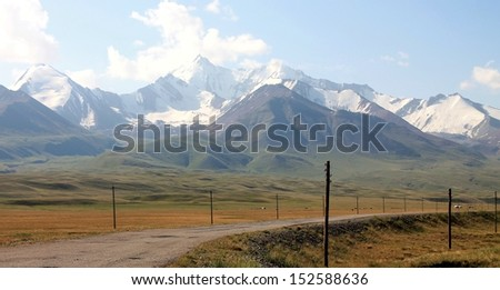 Adventure hiking along dirt road on pamir highway - stock photo
