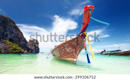 Adventure landscape background. Wooden fishing boat on sea coast of tropical island in Thailand at sunny day of summer vacations in Asia - stock photo