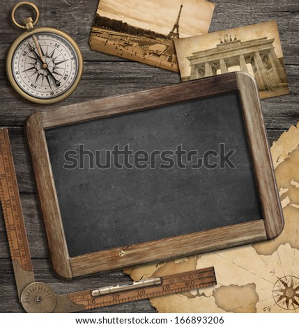 adventure nautical background with vintage treasure map, blackboard and compass - stock photo