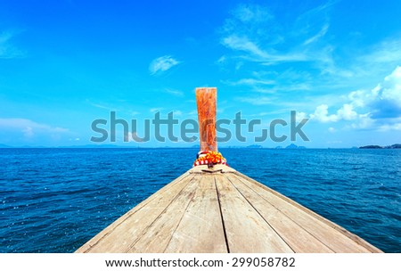 Adventure seascape background of trip journey by tourist boat in Thailand at clear summer day with blue sky. Point of view photography of ship moving  - stock photo