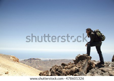 adventurous spanish mountain climber on the top of Teide
