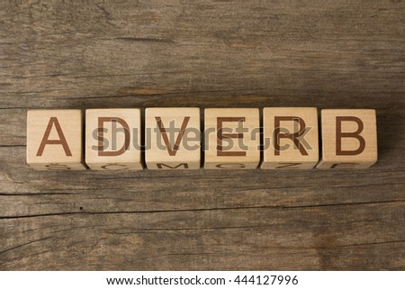 ADVERB word on wooden cubes - stock photo