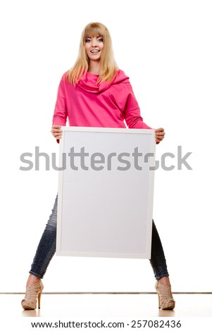 Advertisement concept. Fashion woman full body with blank presentation board. Female model showing banner sign billboard copy space for text. Isolated - stock photo