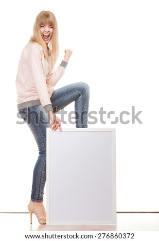 Advertisement concept. Fashion woman full body with blank presentation board. Female model showing banner sign while celebrating success. Isolated - stock photo