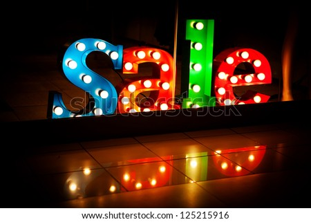 advertisement Sale in the shop at night - stock photo