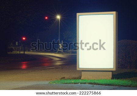 Advertising billboard glowing in the street - stock photo