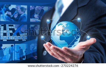 Advertising. Businessman holding world .Technology concept - stock photo