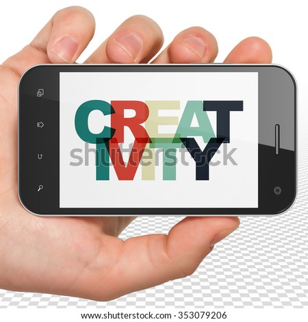 Advertising concept: Hand Holding Smartphone with Painted multicolor text Creativity on display - stock photo