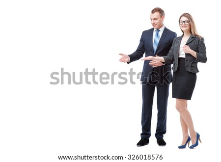 Advertising your product. Full length of happy young couple businessman and businesswoman pointing copy space and smiling while standing isolated on white - stock photo