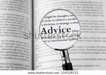 Advice holding Magnifying Glass. Studio Shot . - stock photo