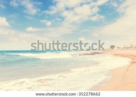 Aegan sea and Malia beach, Crete, Greece, rtero toned - stock photo