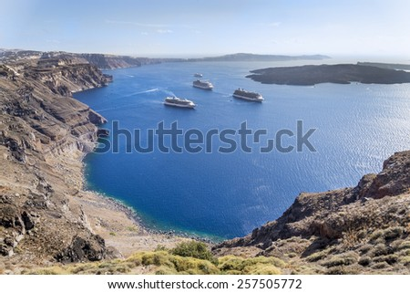 Aegean sea landscape, Santorini, Greece Several cruise ships arrive to the spectacular island of Santorini in the Cyclades.  - stock photo