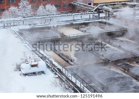 Aeration basin with evaporation in winter season in water treatment plant - stock photo