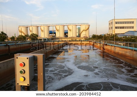 Aeration of waste-water in sewage treatment plant. - stock photo