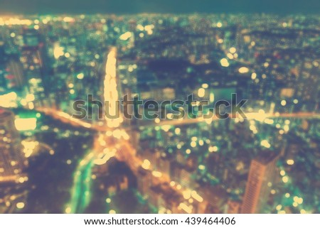 Aerial blurred urban background scene at night - stock photo