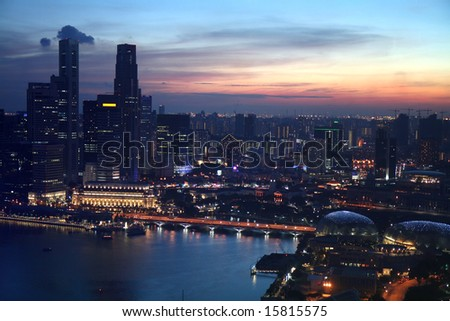 Aerial city skyline of Singapore during sunset at Marina Bay. - stock photo