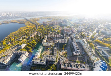 Aerial city view with crossroads, roads, houses, buildings, parks and parking lots, bridges. Copter shot. Panoramic image. - stock photo