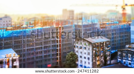 Aerial cityscape panorama view of building construction at sunrise. Tilt shift effect. Yangon, Myanmar (Burma) travel landscapes and destinations - stock photo