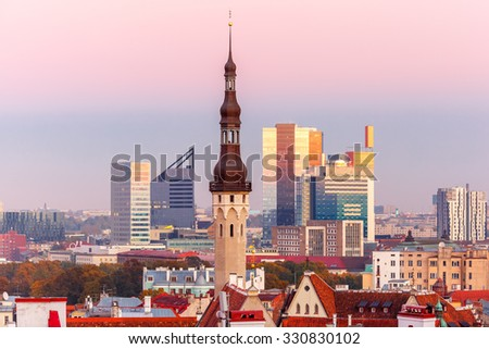 Aerial cityscape with old town hall spire and modern office buildings skyscrapers in the background in Tallinn at sunset, Estonia