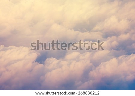 Aerial cloudscape from the airplane board - instagram style - stock photo