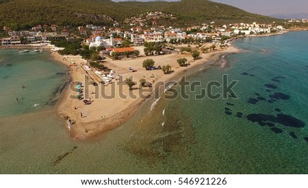 Aerial drone view of Agistri island, Skala beach with turquoise waters, Saronic gulf, Greece