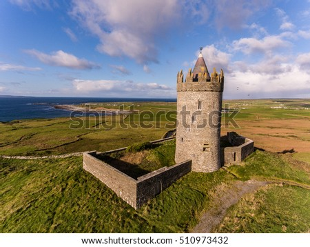 Aerial Famous Irish Tourist Attraction In Doolin, County Clare, Ireland. Doonagore Castle is a round 16th-century tower Castle. Aran Islands and along The Wild Atlantic Way.