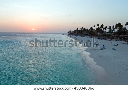 Aerial from Manchebo beach on Aruba island in the Caribbean Sea at sunset - stock photo