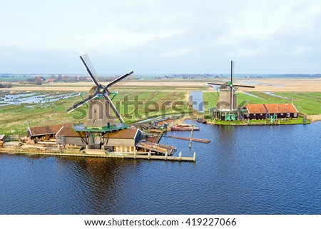 Aerial from traditional windmills at Zaanse Schans in the Netherlands - stock photo