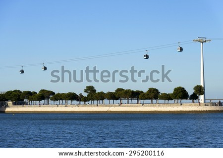 Aerial gondolas in the Nations Park in a summer day in Lisbon, Portugal - stock photo