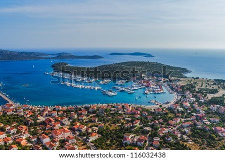Aerial helicopter photo of marina with boats and sailboats, Adriatic tourist destination Rogoznica, Croatia