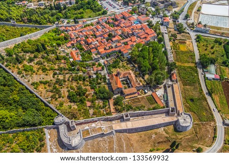 Aerial helicopter photo of medieval town Ston, famous second world largest stone wall, Peljesac peninsula near Dubrovnik, Croatia. - stock photo