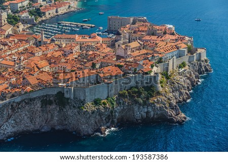 Aerial helicopter shoot of Dubrovnik old town. - stock photo