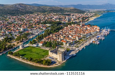 Aerial helicopter shoot of Trogir old town panorama with Kamerlengo Castle in front. Croatia tourist destination. - stock photo