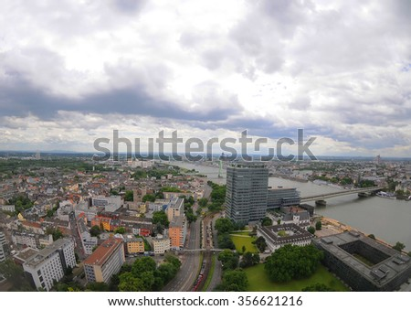 Aerial image of the beautiful city of Cologne (Koln), Germany view over the Rhine River on a white cloudy day. - stock photo