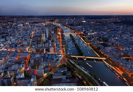 Aerial image of the Seine river and beautiful illuminated quarters in Paris. - stock photo
