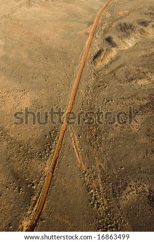 Aerial landscape of rural dirt road in Utah, United States.