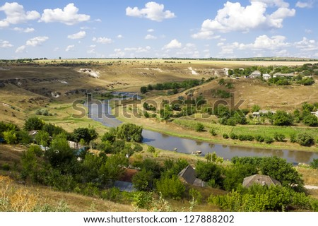 Aerial landscape view of a rural area under blue sky. Ghindesti, Moldova - stock photo