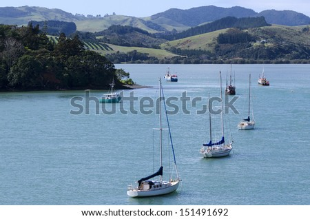 Aerial landscape view of Mangonui harbor with yachts and fishing boats in Northland New Zealand.