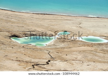 Aerial landscape view of sinkholes in the Dead Sea, Israel. - stock photo