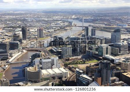 Aerial melbourne city view with tall buildings and river running through middle - stock photo