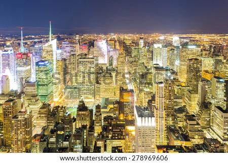 Aerial New York City skyline urban skyscrapers at night, USA. - stock photo