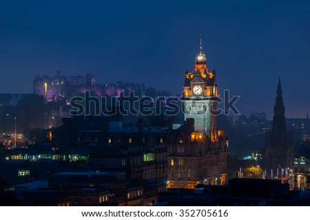 Aerial night view of Edinburgh, Scotland with illuminated castle and The Balmoral Hotel clock tower - stock photo