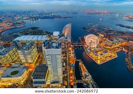 Aerial night view of Yokohama Cityscape and bay at Minato Mirai waterfront district from yokohama landmark tower - stock photo