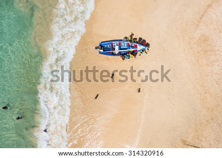 Aerial of a traditional fisher boat in Santa Maria  in Sal Island in Cape Verde - Cabo Verde - stock photo