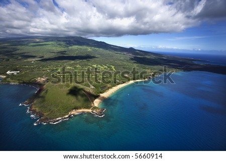 Aerial of coastline with sandy beach and crater and Pacific ocean in Maui, Hawaii. - stock photo