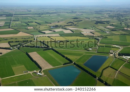 Aerial of dairy and cropping farms in Canterbury, South Island, New Zealand. The large ponds collect effluent from the dairy farms for irrigation.