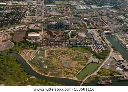 Aerial of industrial harbour and waterway - stock photo