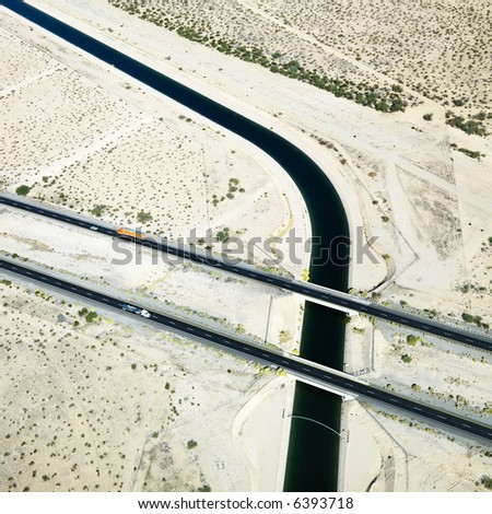 Aerial of interstate 10 highway crossing over Colorado River Aqueduct in Arizona.
